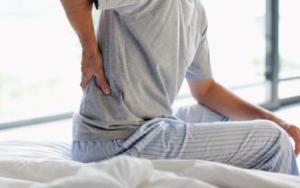 тянущая боль в пояснице отдающая в ноги